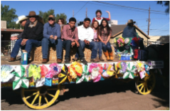 ACE students riding on a student-decorated float at the Tucson Rodeo Parade
