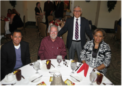 Board members Arturo, Mike and Debra with Tucson Youth Development's Executive Director at TYD's 2014 Holiday Luncheon